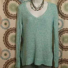 MINT GREEN & WHITE SWEATER! This V neck sweater is a fav! It's very soft and comfortable with long sleeves and small slots on each side. The mint green and white are mingled and it's very pretty. I wore it on more than several occasions but it's in great shape and has no stains, pills or snags. Sweaters Crew & Scoop Necks