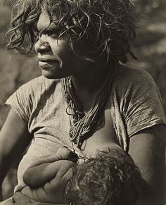 Western Australian Aboriginal woman breast feeding on the Canning Stock route, photo by Axel Poignant, 1942 (Collection: NGA)