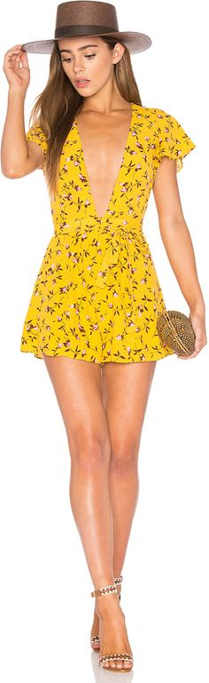 This yellow, floral summer romper is EVERYTHING I need for a sunny day on the beach!  Privacy Please x REVOLVE Goodwin Romper