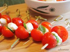 Caprese canape' bites ... lovely to look at ... healthy ... tasty ... and make ahead of time.  PERFECT for engament party, rehearsal or wedding nibbles.  YUM!