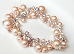 Peach Chunky Pearl + Freshwater Pearl Crystal Bracelet by Something Jeweled @ Etsy. $145.
