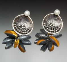 So Young Park  beautiful metal earrings.  More jewelry inspiration on the site.