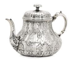 George Ivory Teapot | hallmarked London, 1854 - Silver, with ivory fillets height: 19cm., 7 1/2 in.; weight: 437.5gr., 10oz | Sotheby's