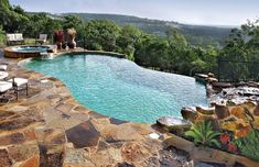 Infinity/Vanishing-Edge Pool Photos : infinity edge pool with rock waterfall and spa Infinity Pools, Infinity Pool Backyard, Infinity Edge Pool, Inground Pool Designs, Swimming Pool Designs, Backyard Pool Landscaping, Backyard Pool Designs, Landscaping Ideas, Landscaping Blocks