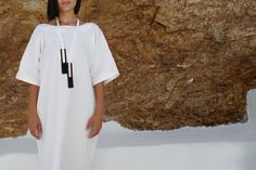 Long necklace in black and white leather Leather Ring, White Leather, Cheap Sandals, White Sandals, Perfectly Imperfect, Italian Leather, Black Shoes, Short Sleeve Dresses, Shirt Dress