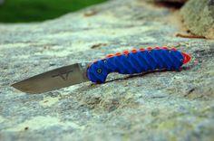 Ontario RAT model 1 custom blue G10 scales with orange backspacer