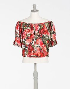 <i>The Spring-Summer 2017 is a journey towards an imaginary Italian Tropic, where the icons traditionally associated with Italy, like bread, pasta and good luck charms are merged with a holiday atmosphere, punctuated by cocktails, ice cream and sequins.</i><br><br>Cotton poplin top with rose print:<br>• Gathered neck and hem<br>• Low shoulders with puff sleeves<br>• Unlined<br>• The mannequin measures 22 inches from the back collar seam and...