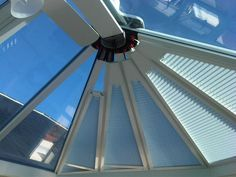 Fully operable triangular pleated roof blinds in a shaped #conservatory roof.