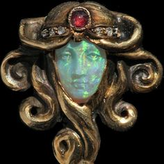 Stickpin of opal, ruby, diamond and gold by Wilhelm Lucas Von Cranach, c. 1900 | A Short History: Carved Opal Jewels | The Jewelry Loupe