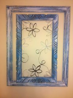 Wall art made with toilet paper rolls, hot glue, paint and a frame. Made it in about an hour... super easy and it looks great!