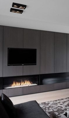 40 Unique TV Wall Unit Setup Ideas It is often believed that the advent of TV in our lives has set a distance in our lives and relationships. But with crafty use of the TV wall unit setup can ensure that this is not the case. Living Room Tv, Living Room With Fireplace, Home And Living, Living Spaces, Modern Fireplace, Fireplace Wall, Fireplace Design, Black Fireplace, Wall Units With Fireplace