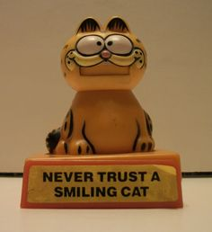 "Vintage Garfield ""Never Trust a Smiling Cat"" Push-Action Collectible Figure- 1981 by TimsTimelessToys on Etsy"