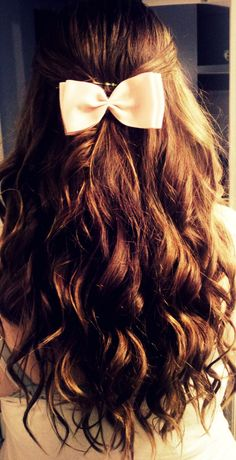 Half up, half down curls with a delicate bow. Love it!!