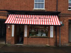 The traditional Victorian awning was fitted by Deans Blinds And Awnings in the 1930's and still today we visit to replace fabrics, and timber parts as required, this shop blinds still looks fantastic