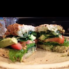 My lunch today! Kale, spinach, lettuce, avocado and tomato stuffed between two pieces of flaxseed bread (was so surprised how much I likes the gluten free bread!!!) and smothered in Kimberly Snyder's basil-mint dressing. AWESOME!!!!