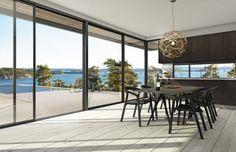 Chili möbler i modern matsal utanför Haninge. Vackra moderna stolar och matsalsbord. Utsikt över poolområde och havet längre bort.