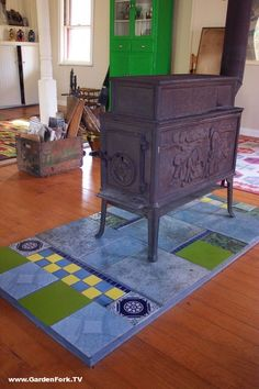 DIY woodstove floor protector. Made out of DuRock tile subfloor and recycled tiles from the bathroom tile DIY project. This woodstove looks great sitting on the repurposed tiles. More cool DIY and other fun videos on our site, www.GardenFork.TV