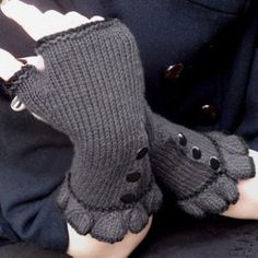 Neo-Victorian inspired ruffled fingerless gloves. Each glove features three buttons and a delicate bell ruffle.