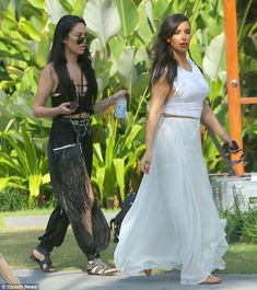 Always on hand: Kim's Kardashian photographer joined her for the day out