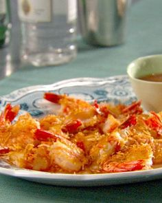 """Lightly fried coconut shrimp is served with a spicy-sweet dipping sauce for a fun and easy party appetizer. From the book """"Lucinda's Authentic Jamaican Kitchen,"""" by Lucinda Scala Quinn (Wiley). Healthy Coconut Shrimp, Coconut Shrimp Recipes, I Love Food, Good Food, Yummy Food, Yummy Eats, Jamaican Recipes, Jamaican Appetizers, Appetizers For Party"""