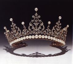 Kent Festoon tiara - A diamond tiara, probably English, circa 1900. An alternating fringe of graduated volutesm each surmounted by a pearl.  This jewel was a favorite of Princess Marina, Duchess of Kent. Now worn by Princess Michael of Kent and its height has been increased by the addition of a string of pearls around the base.