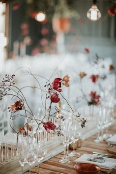 Stunningly beautiful wedding reception floral decor with wild, red, and wintery vibes | image by Dearheart Photography   #weddingphotoinspiration #weddingphotoideas #centerpieces #reception #weddingreception #weddingreceptioninspo #receptioninspiration #receptiondecor #receptioninspo #finishingtouches #weddingdecor #tablescape #floraldesign