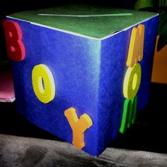Baby shower Money box. Construction paper, some letter sponges, box, double sided tape and glue.
