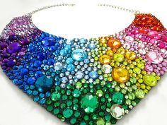 This handmade rainbow statement piece is completely adorned with a colorful ombre of rhinestones. Colorful red rhinestones blend out into