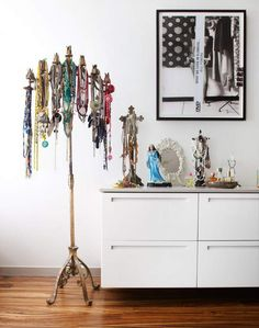 Jewel draped candelabra for storage/display of necklaces | Photography by Kat Teutsch