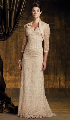 My favorite so far. Two-piece lace dress set, sleeveless A-line dress with front and back scalloped V-necklines, sweep train, matching lace bolero jacket with three-quarter length sleeves, satin trim and rolled rosette accents. Mother Of Groom Dresses, Mothers Dresses, Mother Of The Bride, Mature Wedding Dresses, Lace Bridesmaid Dresses, Dress Prom, Gold Bridesmaids, Bride Gowns, Wedding Gowns