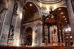 Inside St-Peter's Basilica in Vatican City, Rome, italy. (The altar with Bernini's baldacchino)