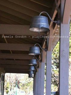Love these washtubs turned upside down and repurposed as porch light covers!