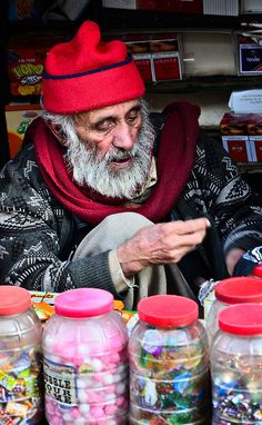 Old man selling sweets by ShaukatNiazi, via Flickr