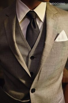 Classic three piece suit with crisp white shirt and matching pocket square = Timeless