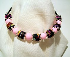 Simple Memory Wire Bracelet with Handmade Polymer Clay Bead and Pink Glass Beads…