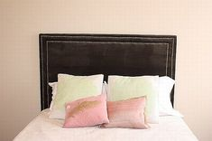 This headboard is as easy as 1-2-3! Choose your favorite fabric and nail heads to create any style you want!