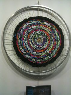 spiders, recycling - bike wheel weaving sculpture