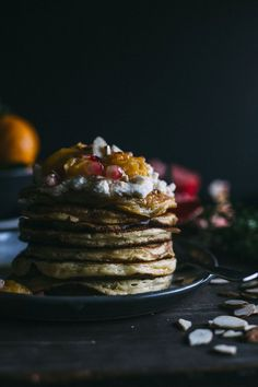 Almond Pancakes with Satsuma Compote | Almond flavored pancakes topped with whipped mascarpone and a simple satsuma compote--talk about a tasty breakfast! | thealmondeater.com