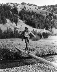 Gary Cooper crossing the river during a hunting trip with Ernest Hemingway, Sun Valley, Idaho  Robert Capa
