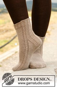 """February is #Sockalicious! Knitted DROPS socks with cables in """"Fabel"""". ~ #DROPSDesign #Garnstudio"""