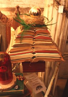 """Love the way these vintage books are displayed!   This was a Christmas display, but I would use it throughout the year, just change out the """"top part"""""""