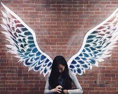 Angel wings mural graffiti