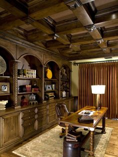 LOVE the box ceiling and heavy wooded matching wall unit - awesome in a living room or den!