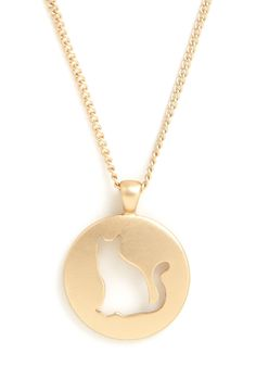 <p>You love your furry feline friends - so much so that you often sport this cute cat necklace! The silhouette of a sitting feline is cut out from the circular, smooth gold pendant of this ModCloth-exclusive necklace, letting the pattern of your blouse underneath peek through for playful pops of color.</p>