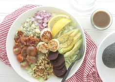 Seared Scallop Cobb Salad With Iceberg Lettuce, Avocado, Crumbled Blue Cheese, Walnuts, Purple Onion, Bacon, Cherry Tomatoes, Beets, Olive Oil, Sea Scallops, Lemon Wedges, Dressing