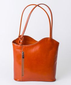 Love this Cognac Asymmetrical Wave Leather Shoulder Bag by Pelleterie Lisa on #zulily! #zulilyfinds