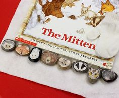 """The Mitten activities using story stones. She shrunk the masks from  Jan Brett's book  """"The Mitten"""" site and put them on rocks. She put numbers on the rocks for math! Read the details; very cute ideas."""