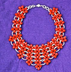 Artisanal necklace made out of red beads. – Fricallery