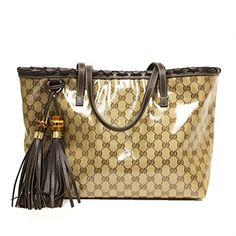 Gucci 354665 Gucci Gg Logo Coated Canvas and Brown Leather Bamboo Tassel Tote Bag Gucci http://www.amazon.com/dp/B00MR7X31C/ref=cm_sw_r_pi_dp_hE0Oub0N6XECH