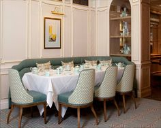Diamond Jubilee Tea Salon at the famous department store Fortnum & Mason in Piccadilly. The room is filled with beautiful sea foam green and tiffany blue colors and was created by the world famous interior designer David Collins.